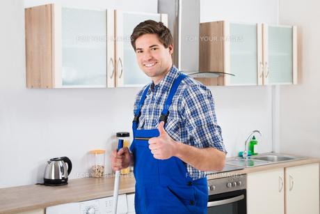 Worker Mopping Floorの写真素材 [FYI00781242]