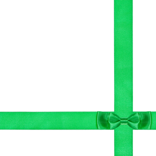 double green bow knot on two crossing silk ribbonsの写真素材 [FYI00781810]