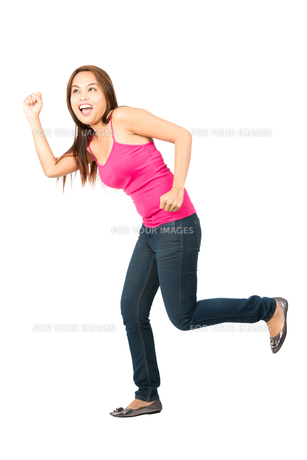 Excited Asian Girl Chasing Something Off-Screenの写真素材 [FYI00782320]