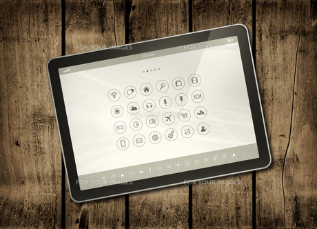 Digital tablet PC on a dark wood tableの写真素材 [FYI00782567]