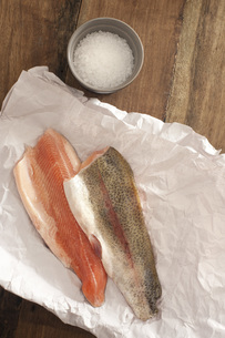 Rainbow Trout Meat on a Table with Saltの写真素材 [FYI00782864]