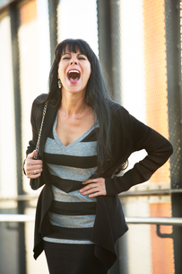 Attractive Woman Laughingの写真素材 [FYI00783454]