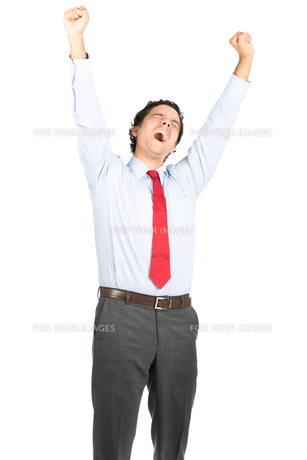 Tired Hispanic Office Worker Yawning Stretchingの写真素材 [FYI00783562]