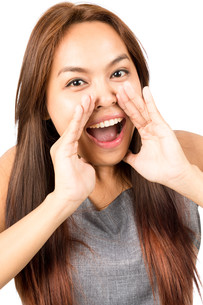 Close up Asian Girl Yelling Hands Around Mouth Vの写真素材 [FYI00783656]