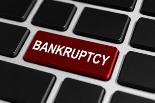 financial bankruptcy button on keyboardの写真素材 [FYI00783696]