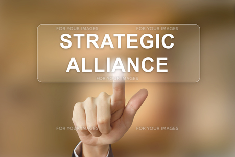 business hand clicking strategic alliance button on blurred backgroundの写真素材 [FYI00783707]