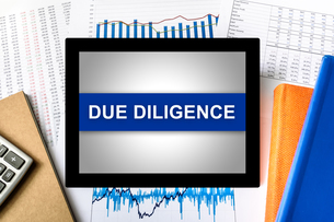 due diligence word on tabletの写真素材 [FYI00783726]