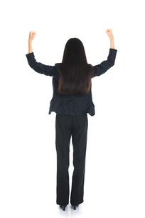 Asian business woman from the back - looking at something isolated over white backgroundの写真素材 [FYI00783801]