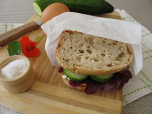 cucumber sandwich in greaseproof paper-bag to take homeの写真素材 [FYI00783818]