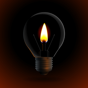 lightbulb with fire candle on dark backgroundの写真素材 [FYI00784541]
