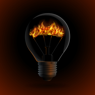 lightbulb with fire isolated on dark backgroundの写真素材 [FYI00784555]