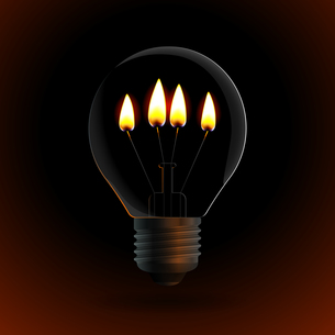 lightbulb with four fire candle on dark backgroundの写真素材 [FYI00784557]