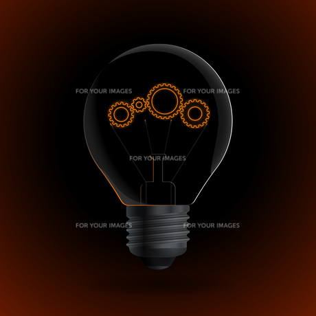 Lightbulb with gear sign on a dark backgroundの写真素材 [FYI00784570]