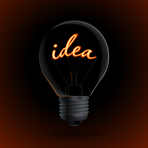 Lightbulb with Idea sign on a dark backgroundの写真素材 [FYI00784588]