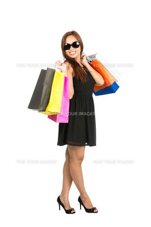 Asian Shopping Bags Over Shoulders Full At Cameraの写真素材 [FYI00784645]