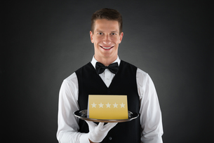 Waiter With Star Rating Boardの写真素材 [FYI00784898]