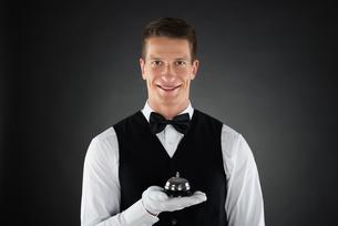 Waiter Holding Service Bellの写真素材 [FYI00784907]