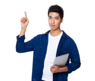 Chinese mixed iranian man hold with tablet and finger point upの写真素材 [FYI00785407]
