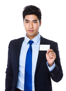 Asian Businessman show with the name cardの写真素材 [FYI00785518]