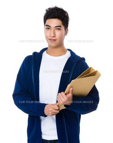 Asian man hold with document workの写真素材 [FYI00785611]