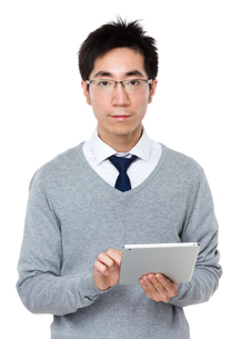 Young businessman touch on tablet pcの写真素材 [FYI00785691]