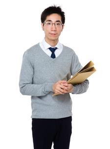 Businessman hold with folderの写真素材 [FYI00785705]