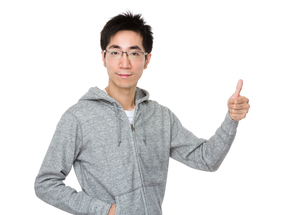 Asian man with thumb upの写真素材 [FYI00785706]