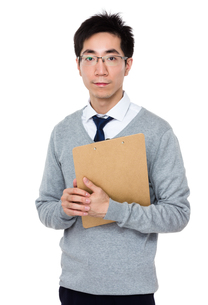 Businessman hold with clipboardの写真素材 [FYI00785707]