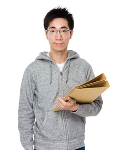 Asian man hold with folderの写真素材 [FYI00785716]