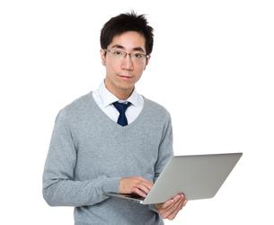 Asian businessman use of laptop computerの写真素材 [FYI00785725]