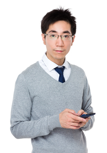Businessman use of cellphoneの写真素材 [FYI00785727]