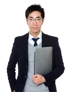 Asian businessman hold with laptop computerの写真素材 [FYI00785732]