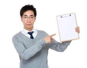 Young businessman finger point to clipboardの写真素材 [FYI00785737]