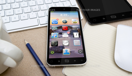 Workplace with mobile phoneの写真素材 [FYI00786238]