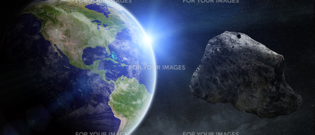 Asteroids threat over planet earthの写真素材 [FYI00786249]