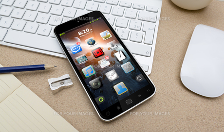 Workplace with mobile phoneの写真素材 [FYI00786263]