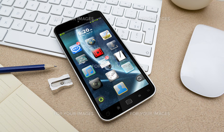 Workplace with mobile phoneの写真素材 [FYI00786269]