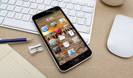 Workplace with mobile phoneの写真素材 [FYI00786270]