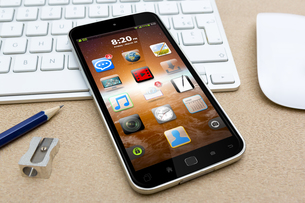 Workplace with mobile phoneの写真素材 [FYI00786288]