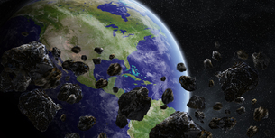 Meteorite impact on planet Earth in spaceの写真素材 [FYI00786324]