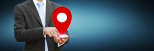 Businessman holding digital map in his handsの写真素材 [FYI00786329]
