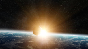 Sunrise over planet Earth in spaceの写真素材 [FYI00786363]