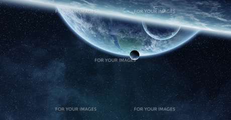 Sunrise over planet Earth in spaceの写真素材 [FYI00786401]