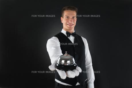 Waiter Holding Service Bellの写真素材 [FYI00786505]