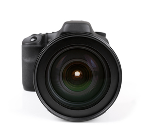 closeup of black photo camera isolated on whiteの写真素材 [FYI00786949]