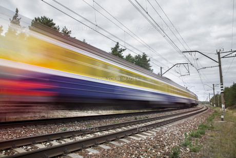 passenger train on railroad tracks in speed motionの写真素材 [FYI00786953]