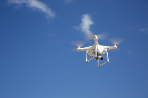 drone flies against blue sky on sunny dayの写真素材 [FYI00786978]