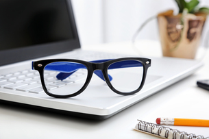 workspace with hipster glasses on laptopの写真素材 [FYI00786991]
