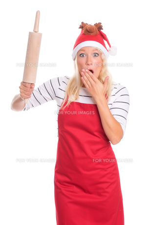 christmas woman in apron holding a rolling pin and is scaredの素材 [FYI00787404]