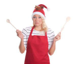 christmas woman with spoons looks skepticalの写真素材 [FYI00787426]